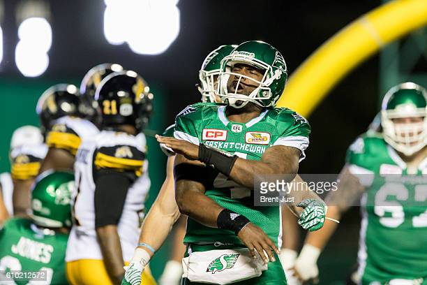 Darian Durant of the Saskatchewan Roughriders celebrates after scoring a touchdown in the first half of the game between the Hamilton TigerCats and...
