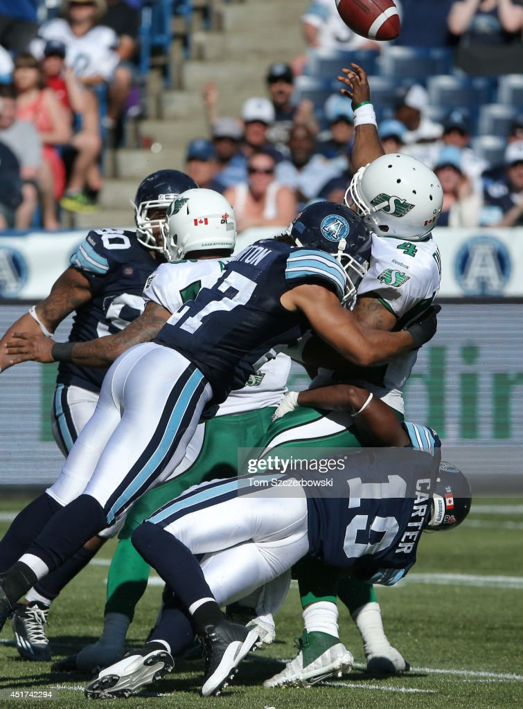 <a gi-track='captionPersonalityLinkClicked' href=/galleries/search?phrase=Darian+Durant&family=editorial&specificpeople=234847 ng-click='$event.stopPropagation()'>Darian Durant</a> #4 of the Saskatchewan Roughriders is sacked Jalil Carter #19 and Shane Horton #27 of the Toronto Argonauts during a CFL game on July 5, 2014 at Rogers Centre in Toronto, Ontario, Canada.