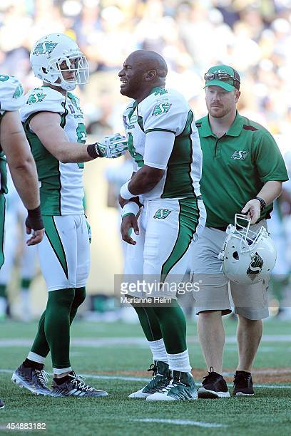 Darian Durant of the Saskatchewan Roughriders is walked off the field after he was injured in second half action in a CFL game against the Winnipeg...
