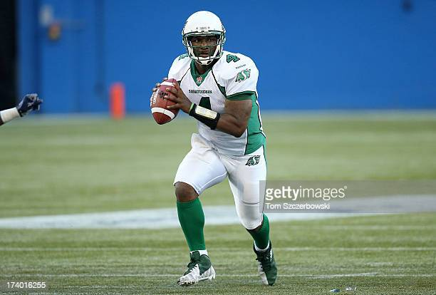 Darian Durant of the Saskatchewan Roughriders looks for a receiver during CFL game action against the Toronto Argonauts on July 11 2013 at Rogers...