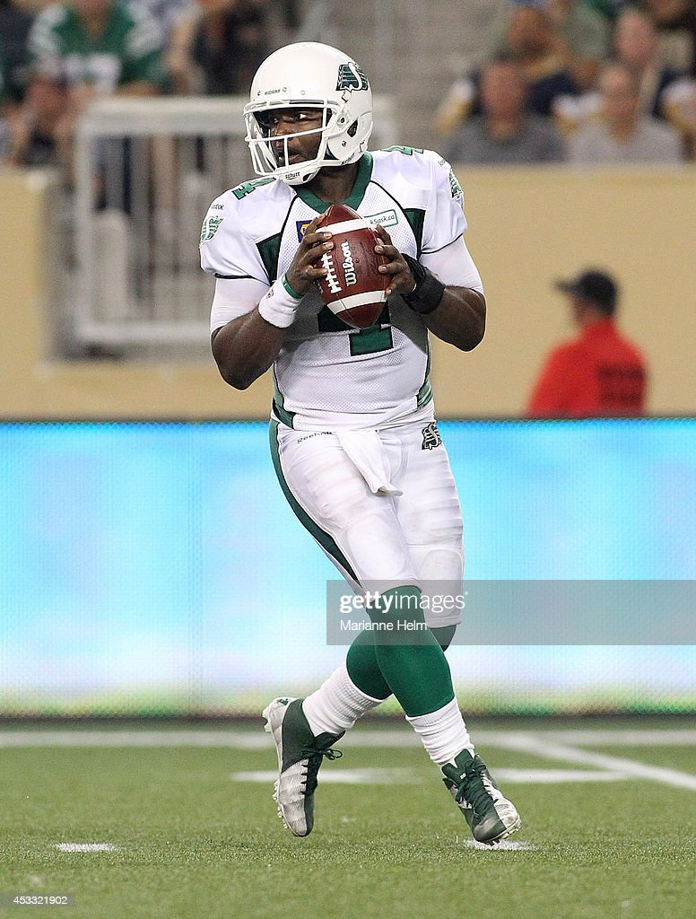 <a gi-track='captionPersonalityLinkClicked' href=/galleries/search?phrase=Darian+Durant&family=editorial&specificpeople=234847 ng-click='$event.stopPropagation()'>Darian Durant</a> #4 of the Saskatchewan Roughriders looks to throw the ball in second-half action in a CFL game against the Winnipeg Blue Bombers at Investors Group Field on August 7, 2014 in Winnipeg, Manitoba, Canada.