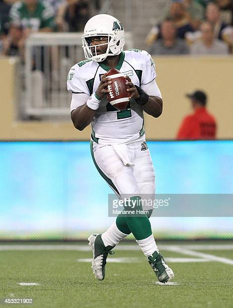 Darian Durant of the Saskatchewan Roughriders looks to throw the ball in secondhalf action in a CFL game against the Winnipeg Blue Bombers at...