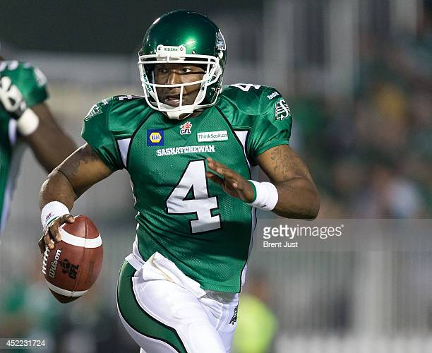 Darian Durant of the Saskatchewan Roughriders runs to escape pressure in a game between the BC Lions and Saskatchewan Roughriders in week 3 of the...