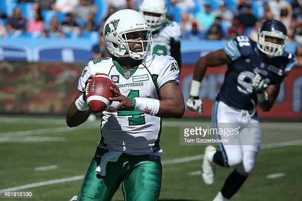 Darian Durant of the Saskatchewan Roughriders scrambles during CFL game action against the Toronto Argonauts on July 5 2014 at Rogers Centre in...