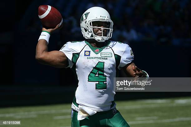Darian Durant of the Saskatchewan Roughriders throws a pass during CFL game action against the Toronto Argonauts on July 5 2014 at Rogers Centre in...