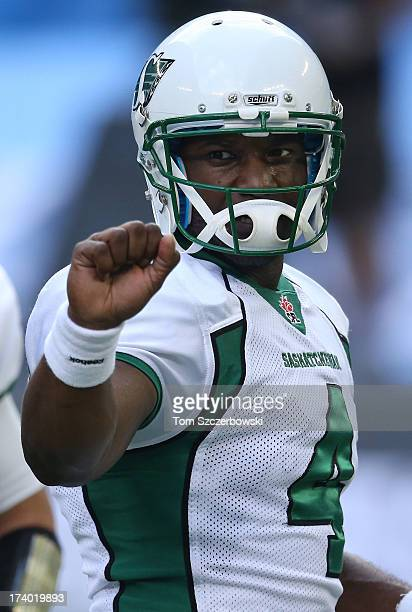 Darian Durant of the Saskatchewan Roughriders warms up before CFL game action against the Toronto Argonauts on July 11 2013 at Rogers Centre in...