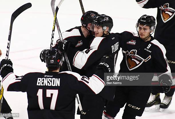 Darian Skeoch of the Vancouver Giants celebrates his goal against the Kelowna Rockets with teammates Tyler Benson Dylan Plouffe and James Malm during...