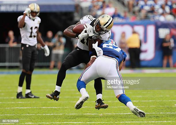 Darian Thompson of the New York Giants attempts to tackle Brandin Cooks of the New Orleans Saints during the second half at MetLife Stadium on...