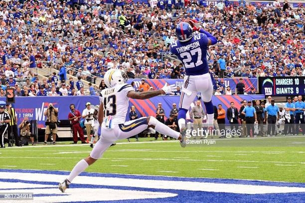 Darian Thompson of the New York Giants catches a touchdown pass against Keenan Allen of the Los Angeles Chargers during an NFL game at MetLife...