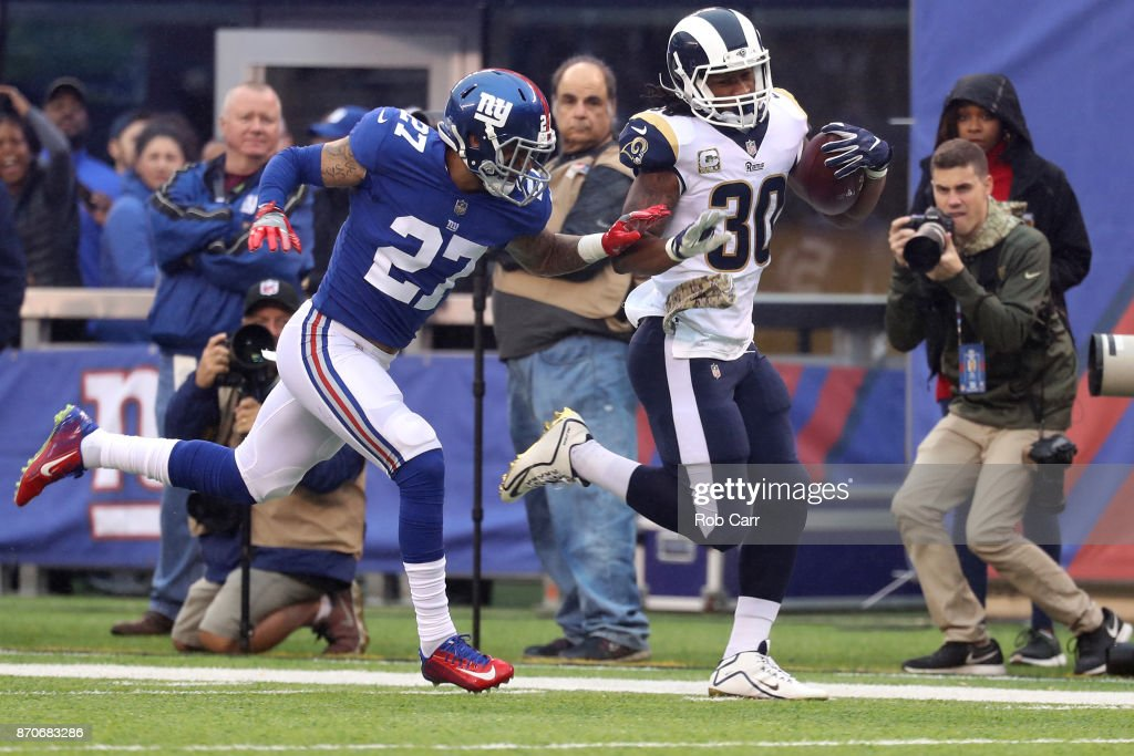 Darian Thompson #27 of the New York Giants pushes Todd Gurley #30 of the Los Angeles Rams out of bounds in the first half at MetLife Stadium on November 5, 2017 in East Rutherford, New Jersey.