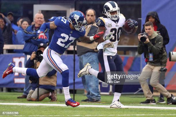 Darian Thompson of the New York Giants pushes Todd Gurley of the Los Angeles Rams out of bounds in the first half at MetLife Stadium on November 5...