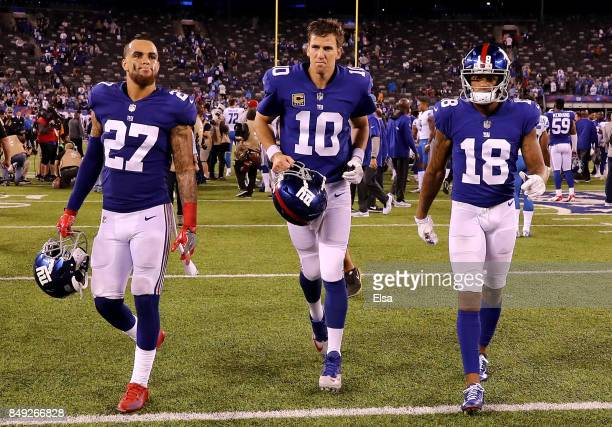 Darian Thompson#27 Eli Manning and Roger Lewis of the New York Giants walk off the field after the game against the Detroit Lions on September 18...