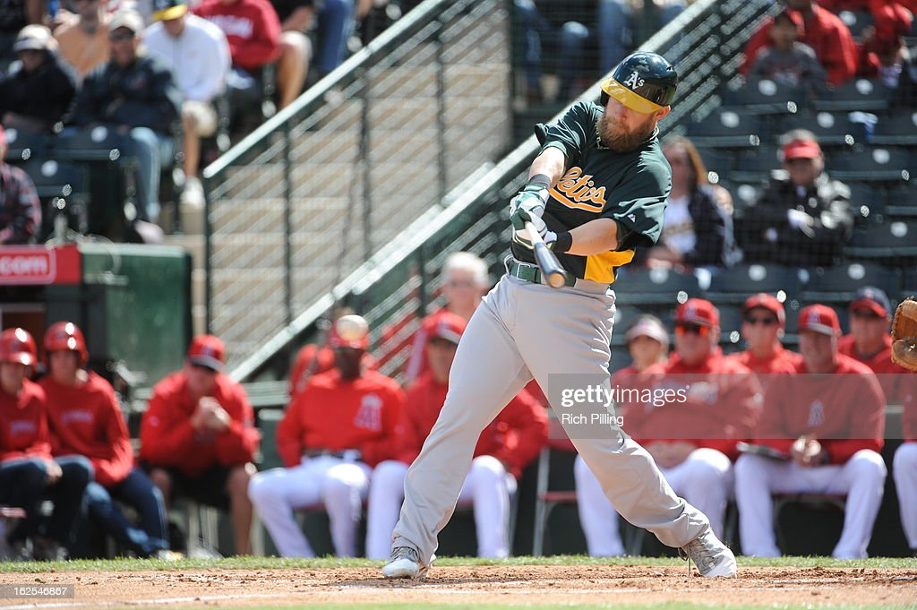 <a gi-track='captionPersonalityLinkClicked' href=/galleries/search?phrase=Daric+Barton&family=editorial&specificpeople=682626 ng-click='$event.stopPropagation()'>Daric Barton</a> #10 of the Oakland Athletics bats during the game against the Los Angeles Angeles of Anaheim on February 24, 2013 at Tempe Diablo Stadium in Tempe, Arizona. The Athletics defeated the Angels 7-5.
