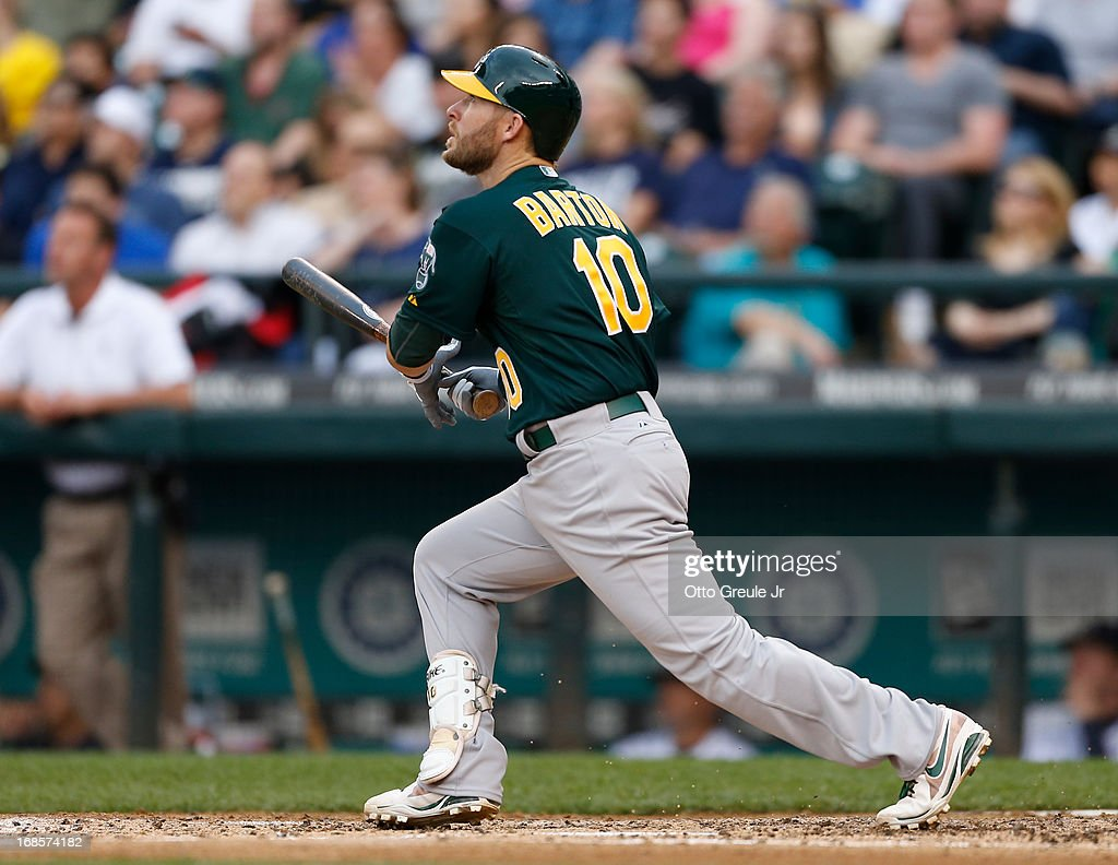 <a gi-track='captionPersonalityLinkClicked' href=/galleries/search?phrase=Daric+Barton&family=editorial&specificpeople=682626 ng-click='$event.stopPropagation()'>Daric Barton</a> #10 of the Oakland Athletics hits a home run in the fourth inning against the Seattle Mariners at Safeco Field on May 11, 2013 in Seattle, Washington.