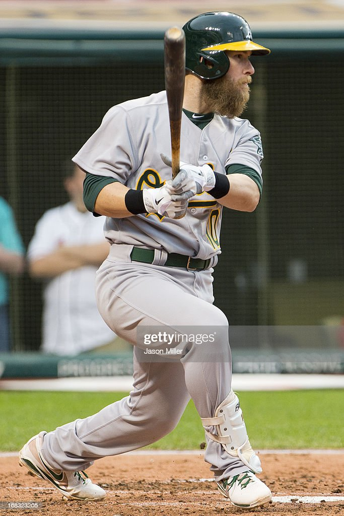 <a gi-track='captionPersonalityLinkClicked' href=/galleries/search?phrase=Daric+Barton&family=editorial&specificpeople=682626 ng-click='$event.stopPropagation()'>Daric Barton</a> #10 of the Oakland Athletics hits a two RBI single during the fourth inning against the Cleveland Indians at Progressive Field on May 8, 2013 in Cleveland, Ohio.