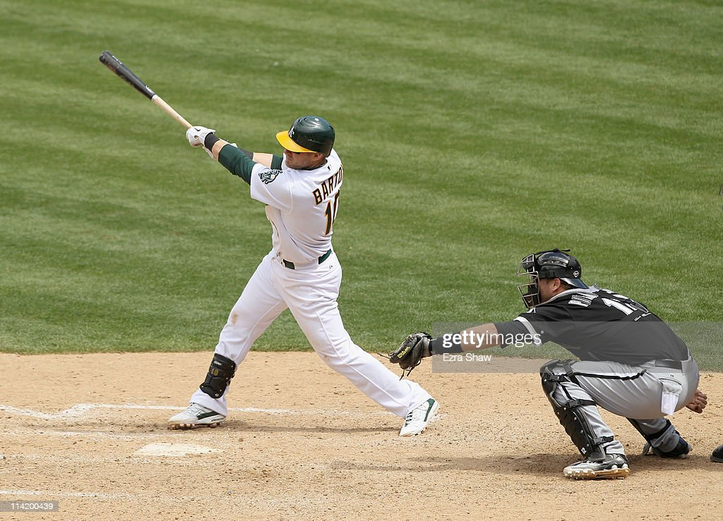 Daric Barton #10 of the Oakland Athletics singles in two runs in the seventh inning against the Chicago White Sox at Oakland-Alameda County Coliseum on May 15, 2011 in Oakland, California.