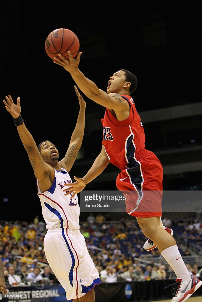 Darien Brothers #3 of the Richmond Spiders goes to the basket against <a gi-track='captionPersonalityLinkClicked' href=/galleries/search?phrase=Markieff+Morris&family=editorial&specificpeople=5293881 ng-click='$event.stopPropagation()'>Markieff Morris</a> #21 of the Kansas Jayhawks during the southwest regional of the 2011 NCAA men's basketball tournament at the Alamodome on March 25, 2011 in San Antonio, Texas. Kansas defeated Richmond 77-57.