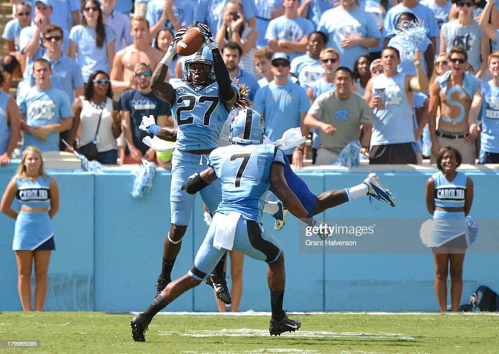 Darien Rankin #27 of the North Carolina Tar Heels interepts a pass intended for Kyle Griswould #9 of the Middle Tennessee State Blue Raiders during play at Kenan Stadium on September 7, 2013 in Chapel Hill, North Carolina. North Carolina won 40-20.