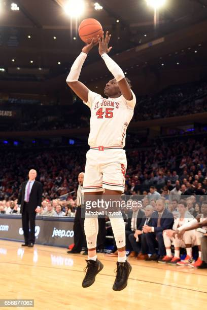 Darien Williams of the St John's Red Storm takes a jump shot during the Big East Basketball Tournament First Round game against the Georgetown Hoyas...