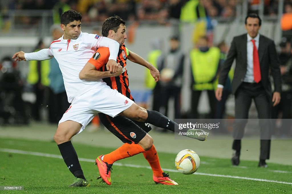 Dariio Srna of Shakhtar Donetsk (R) competes for the ball with Ever Banega (L) of Sevilla FC during the UEFA Europa League Semi-finals soccer match between Shakhtar Donetsk and Sevilla FC at Lviv Arena stadium on April 28, 2016, in Lviv, Ukraine.