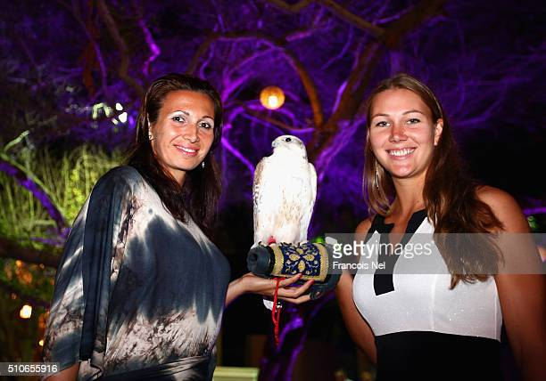 Darija Jurak of Croatia and Nicole Melichar of the United States holds a falcon at the players party during day two of the WTA Dubai Duty Free Tennis...