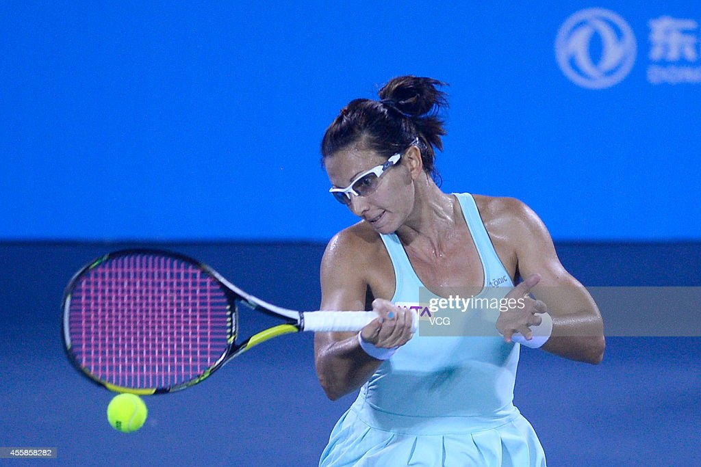 <a gi-track='captionPersonalityLinkClicked' href=/galleries/search?phrase=Darija+Jurak&family=editorial&specificpeople=3047172 ng-click='$event.stopPropagation()'>Darija Jurak</a> of Croatia competes with Casey Dellacqua of Australia and Lisa Raymond of U.S. during day 1 of the 2014 Dongfeng Motor Wuhan Open at Optics Valley International Tennis Center on September 21, 2014 in Wuhan, Hubei province of China.