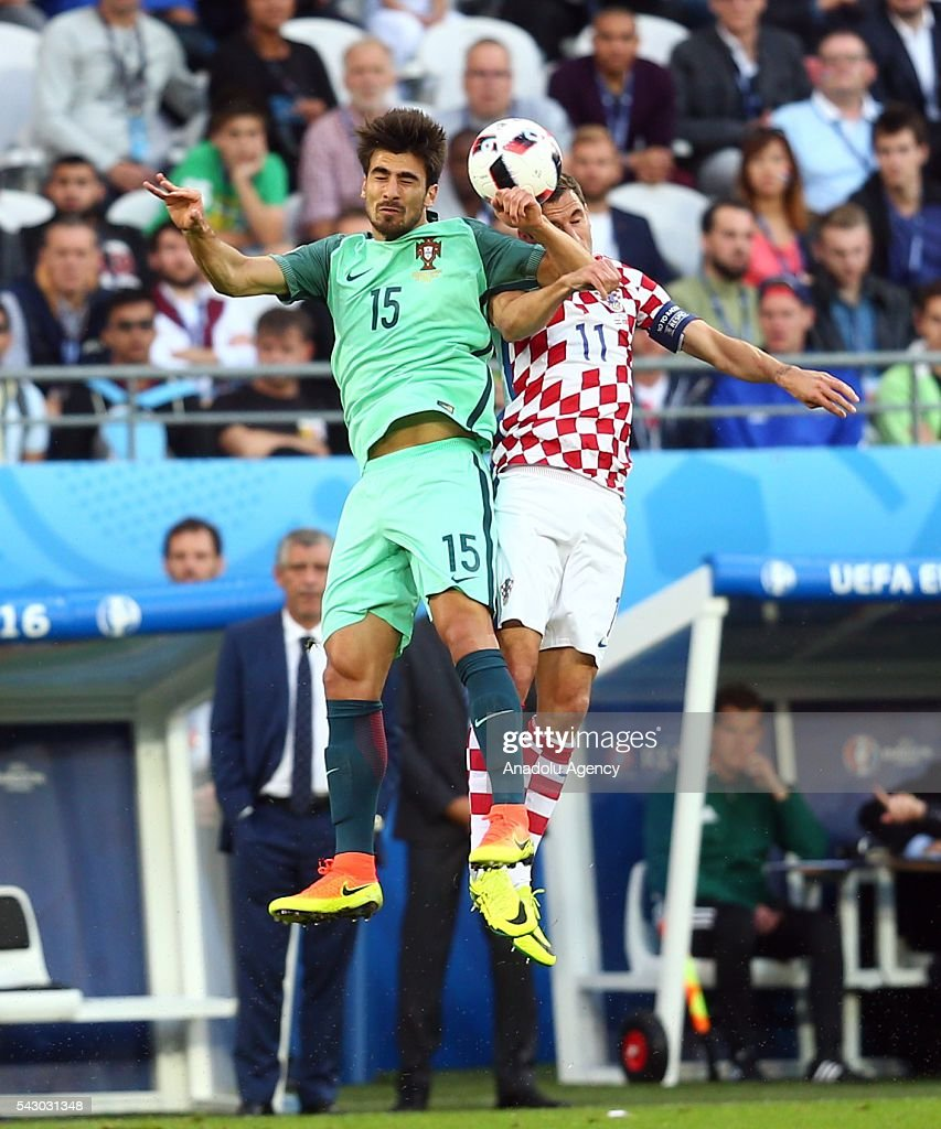 Darijo Srna (R) of Croatia in action against Andre Gomes (L) of Portugal during the Euro 2016 round of 16 football match between Croatia and Portugal at Stade Bollaert-Delelis in Lens, France on June 25, 2016.