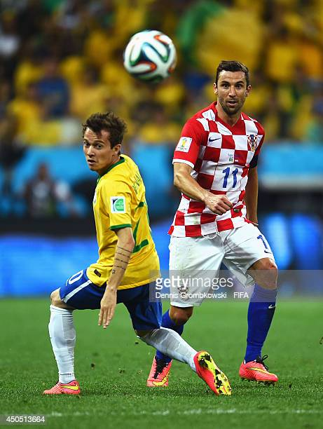 Darijo Srna of Croatia is closed down by Bernard of Brazil during the 2014 FIFA World Cup Brazil Group A match between Brazil and Croatia at Arena de...