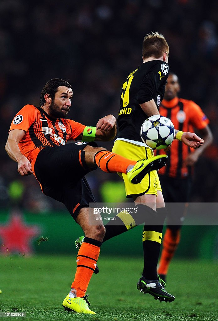Darijo Srna of Donetsk is challenged by Marco Reus of Dortmund during the UEFA Champions League Round of 16 first leg match between Shakhtar Donetsk and Borussia Dortmund at Donbass Arena on February 13, 2013 in Donetsk, Ukraine.