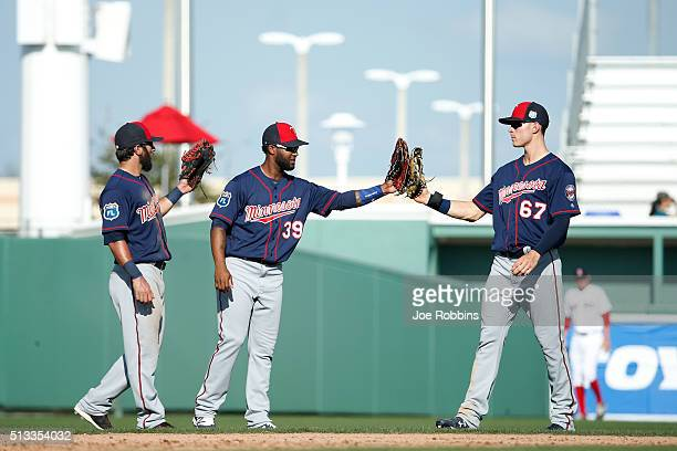 Darin Mastroianni Danny Santana and Max Kepler of the Minnesota Twins celebrate after winning the spring training opener against the Boston Red Sox...