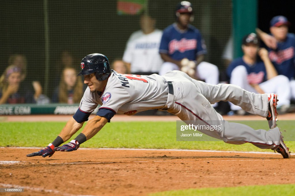 Darin Mastroianni #19 of the Minnesota Twins scores the tying run on an error during the ninth inning against the Cleveland Indians at Progressive Field on August 7, 2012 in Cleveland, Ohio.