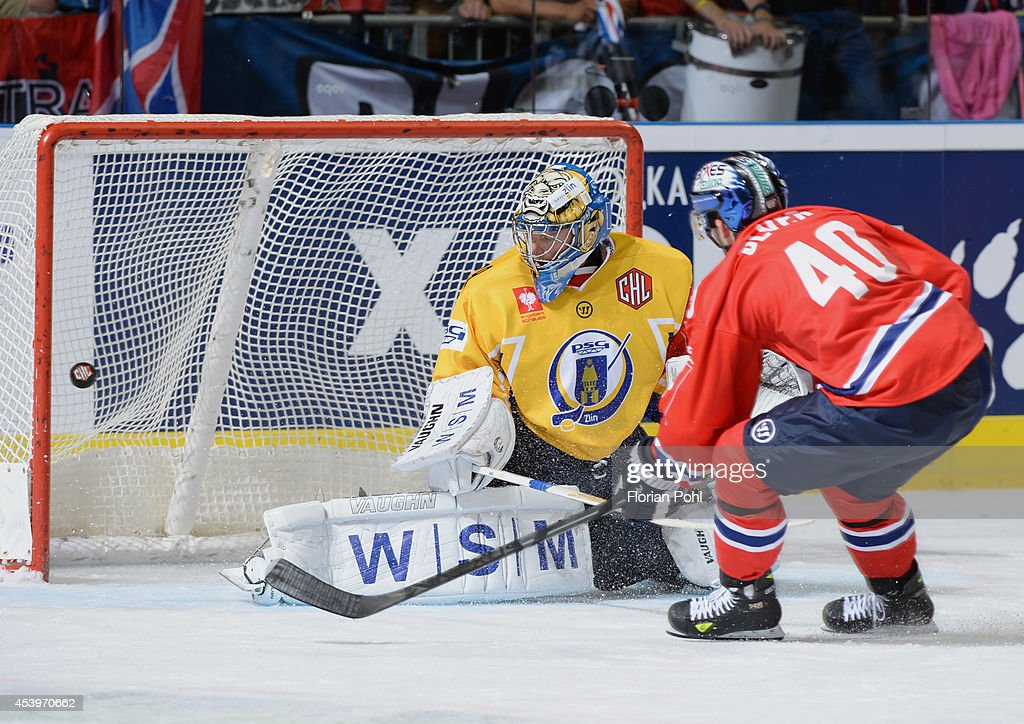 Darin Olver (#40 of Eisbaeren Berlin attempts to score against Lubos Horcicka #79 of PSG Zlin during the Champions Hockey League group stage game between Eisbaeren Berlin and HC Zlin on August 22, 2014 in Berlin, Germany.