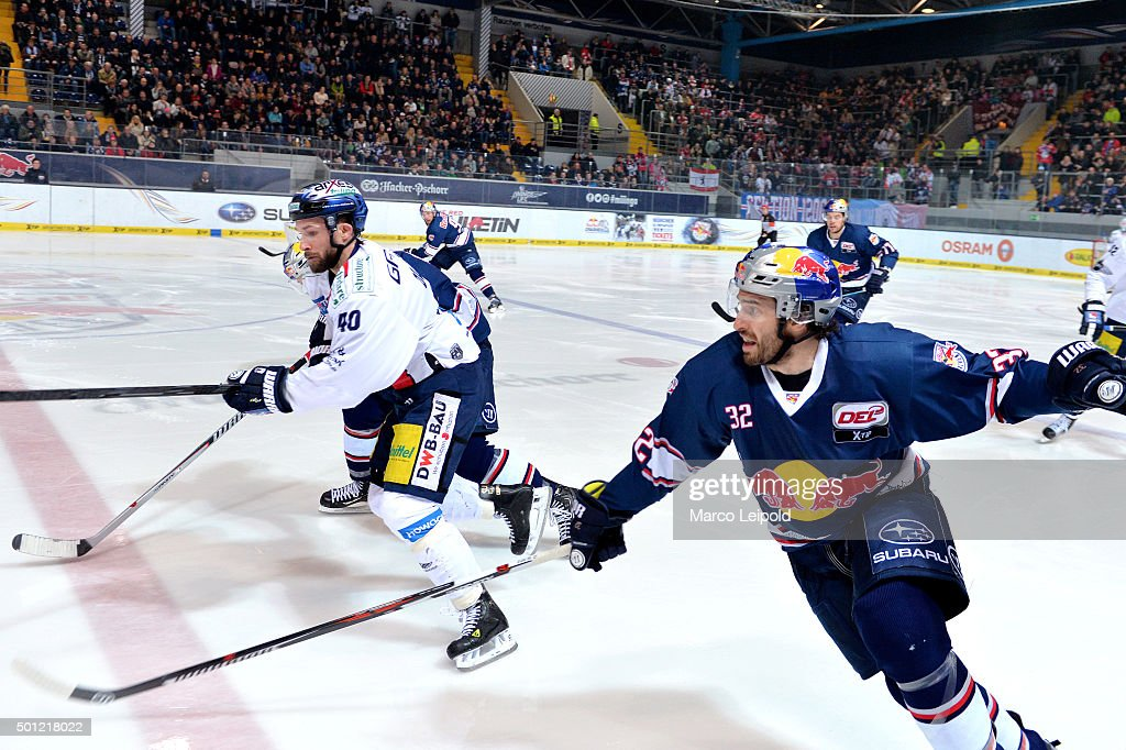 Darin Olver of the Eisbaeren Berlin and Frederic StDenis of EHC Red Bull Muenchen during the game between EHC Red Bull Muenchen and the Eisbaeren...