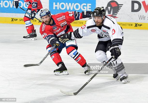 Darin Olver of the Eisbaeren Berlin and Patrick Reimer of the Thomas Sabo Ice Tigers Nuernberg in action during the game between Eisbaeren Berlin and...