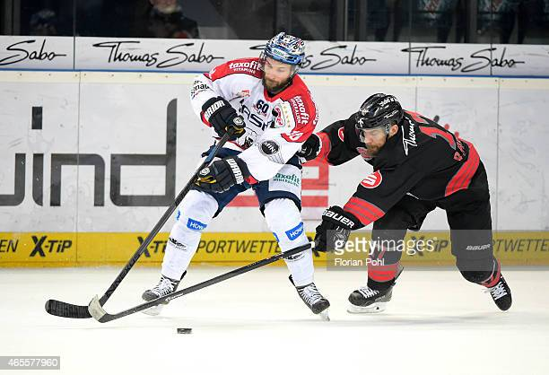 Darin Olver of the Eisbaeren Berlin and Patrick Reimer of the Thomas Sabo Ice Tigers Nuernberg during the game between Thomas Sabo Ice Tigers and...
