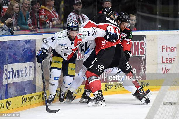 Darin Olver of the Eisbaeren Berlin and Torsten Ankert of the Koelner Haien during the DEL playoff match between Koelner Haie and the Eisbaeren...