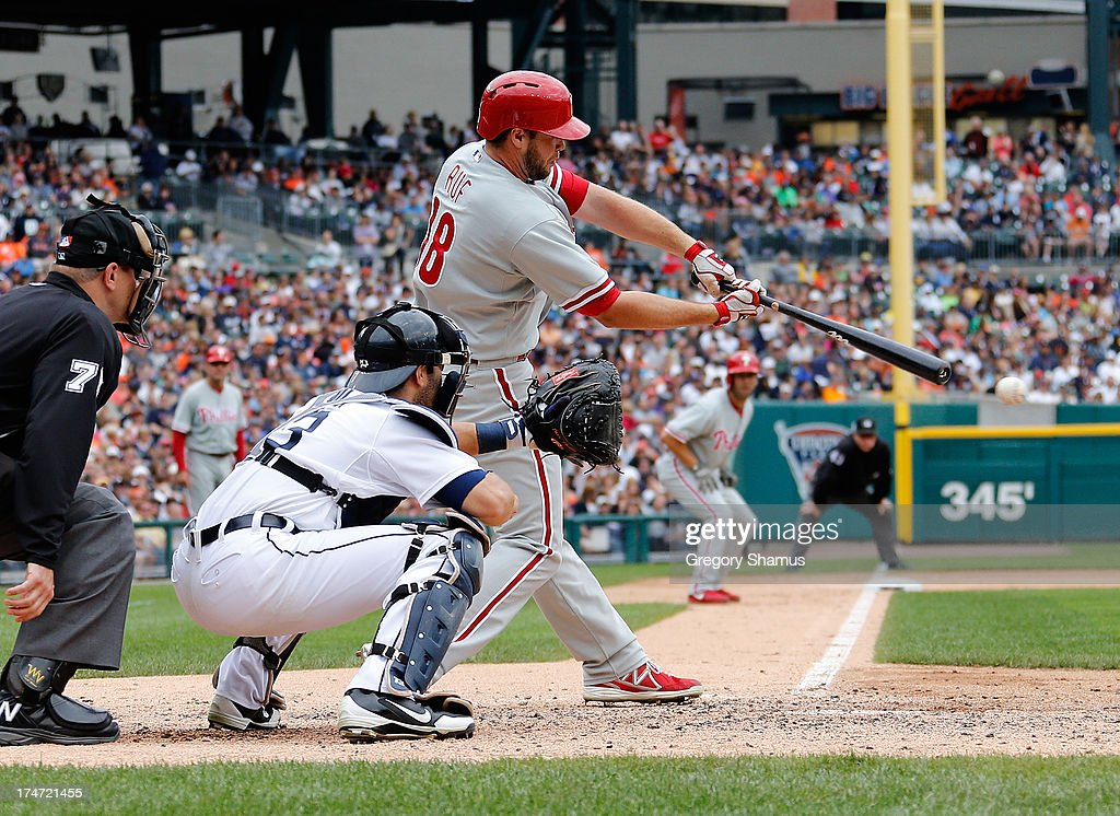 Darin Ruf #18 of the Philadelphia Phillies hits a fifth inning RBI single in front of <a gi-track='captionPersonalityLinkClicked' href=/galleries/search?phrase=Alex+Avila&family=editorial&specificpeople=5749211 ng-click='$event.stopPropagation()'>Alex Avila</a> #13 of the Detroit Tigers at Comerica Park on July 28, 2013 in Detroit, Michigan.