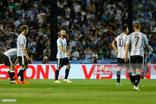 Dario Benedetto Lionel Messi Javier Mascherano and Lucas Biglia of Argentina look dejected after a match between Argentina and Peru as part of FIFA...