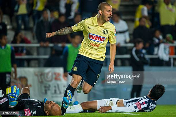 Dario Benedetto of America celebrates after scoring the second goal of his team during a quarterfinal first leg match between Pachuca and America as...