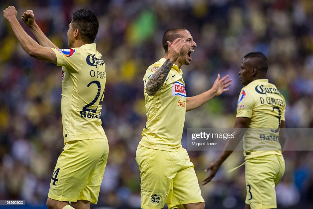 Dario Benedetto of America celebrates after scoring the third goal of his team during a semifinal second leg match between America and Herediano as...