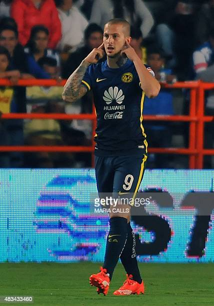Dario Benedetto of America celebrates his goal against Pachuca during their Mexican Football League Apertura Tournament 2015 at the Estadio Hidalgo...