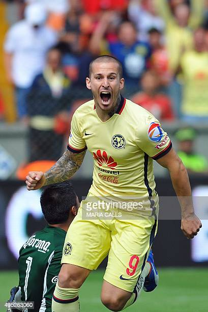 Dario Benedetto of America celebrates his goal against Toluca during their Mexican Apertura tournament football match at the Nemesio Diez stadium in...
