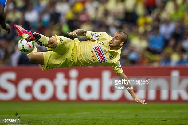 Dario Benedetto of America tries to score during a Championship first leg match between America and Montreal Impact as part of CONCACAF Champions...