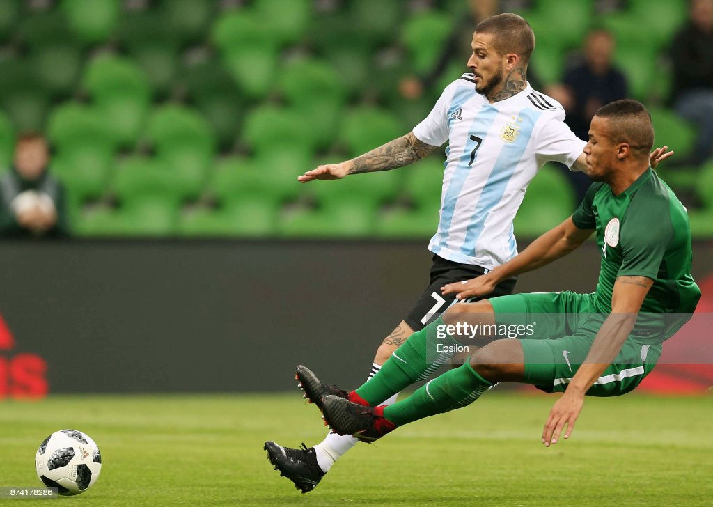 Dario Benedetto of Argentina competes for the ball with William Ekong of Nigeria during an international friendly match between Argentina and Nigeria at Krasnodar Stadium on November 14, 2017 in Krasnodar, Russia.