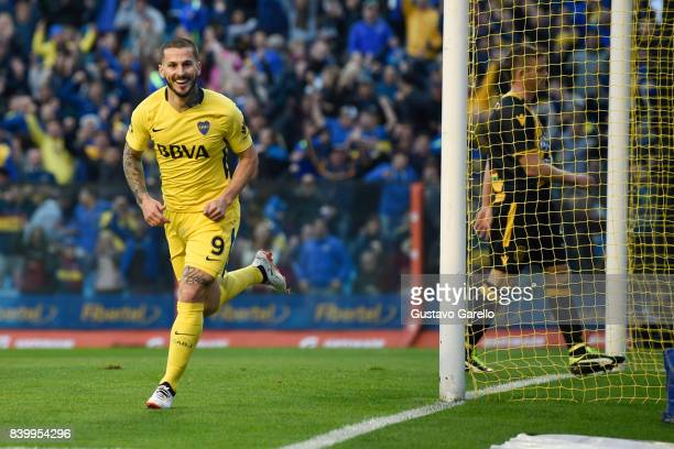 Dario Benedetto of Boca Juniors celebrates after scoring the first goal of his team during a match between Boca Juniors and Olimpo as part of...