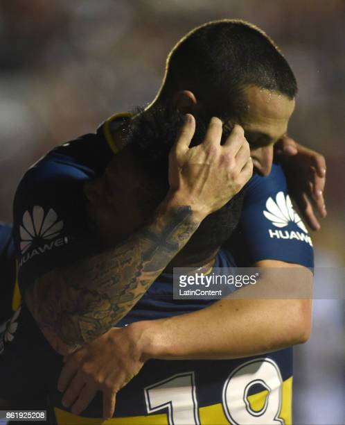 Dario Benedetto of Boca Juniors celebrates with teammate Frank Fabra after scoring the second goal of his team during a match between Patronato and...