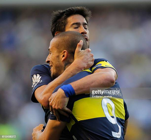 Dario Benedetto of Boca Juniors celebrates with teammate Pablo Perez after scoring the second goal of his team during a match between Boca Juniors...