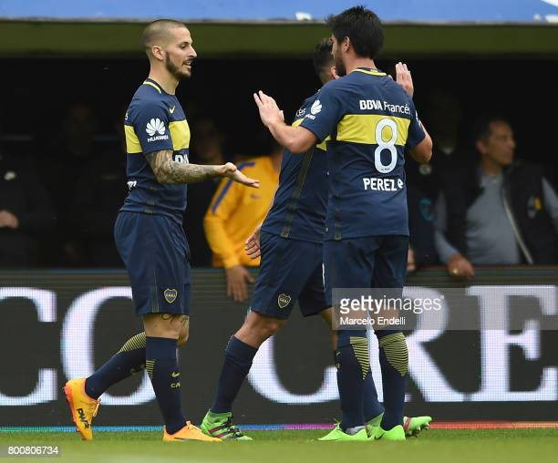 Dario Benedetto of Boca Juniors celebrates with teammate Pablo Perez after scoring the first goal of his team during a match between Boca Juniors and...