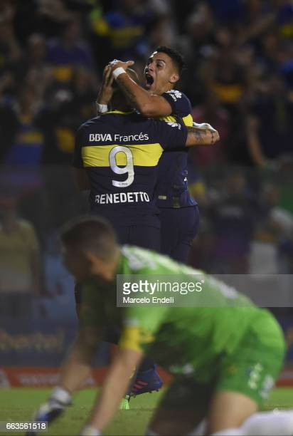 Dario Benedetto of Boca Juniors celebrates with teammate Ricardo Centurion after scoring the first goal of his team during a match between Boca...