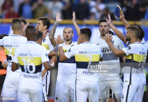 Dario Benedetto of Boca Juniors celebrates with teammates after scoring the first goal of his team during a match between Boca Juniors and Patronato...